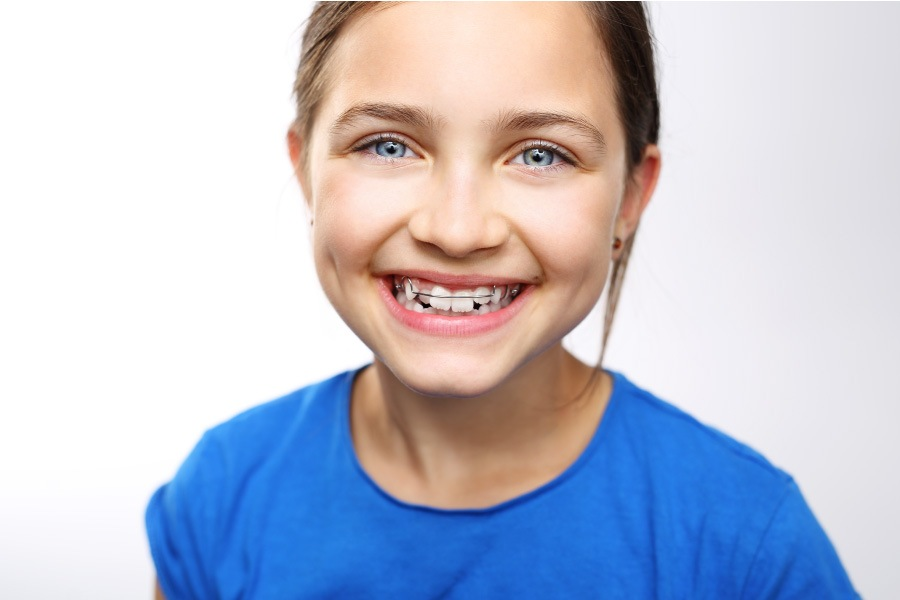 Smiling young girl with early intervention braces.