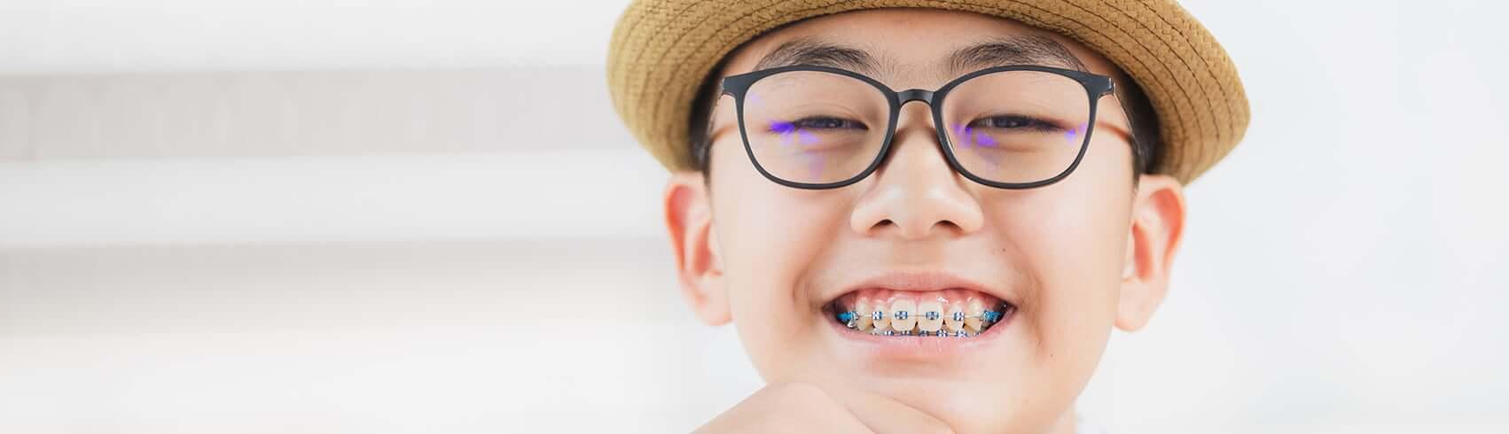 smiling boy wearing braces